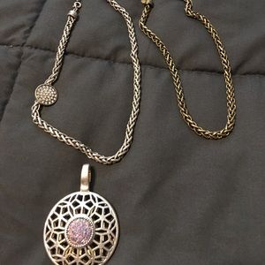 Two tone charm with matching necklaces.